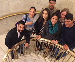 Students and staff stop to take a photo during their tour of the US Supreme Court