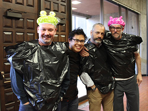 Professors Alex Ritchie, Kevin Tu, Serge Martinez and George Bach prepare for the pie throwing contest.