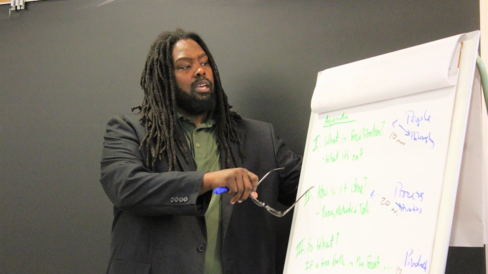 Social Justice Guest Speaker Everette W. Hill models the use of the flipchart as one of the many tools available for effective facilitation.